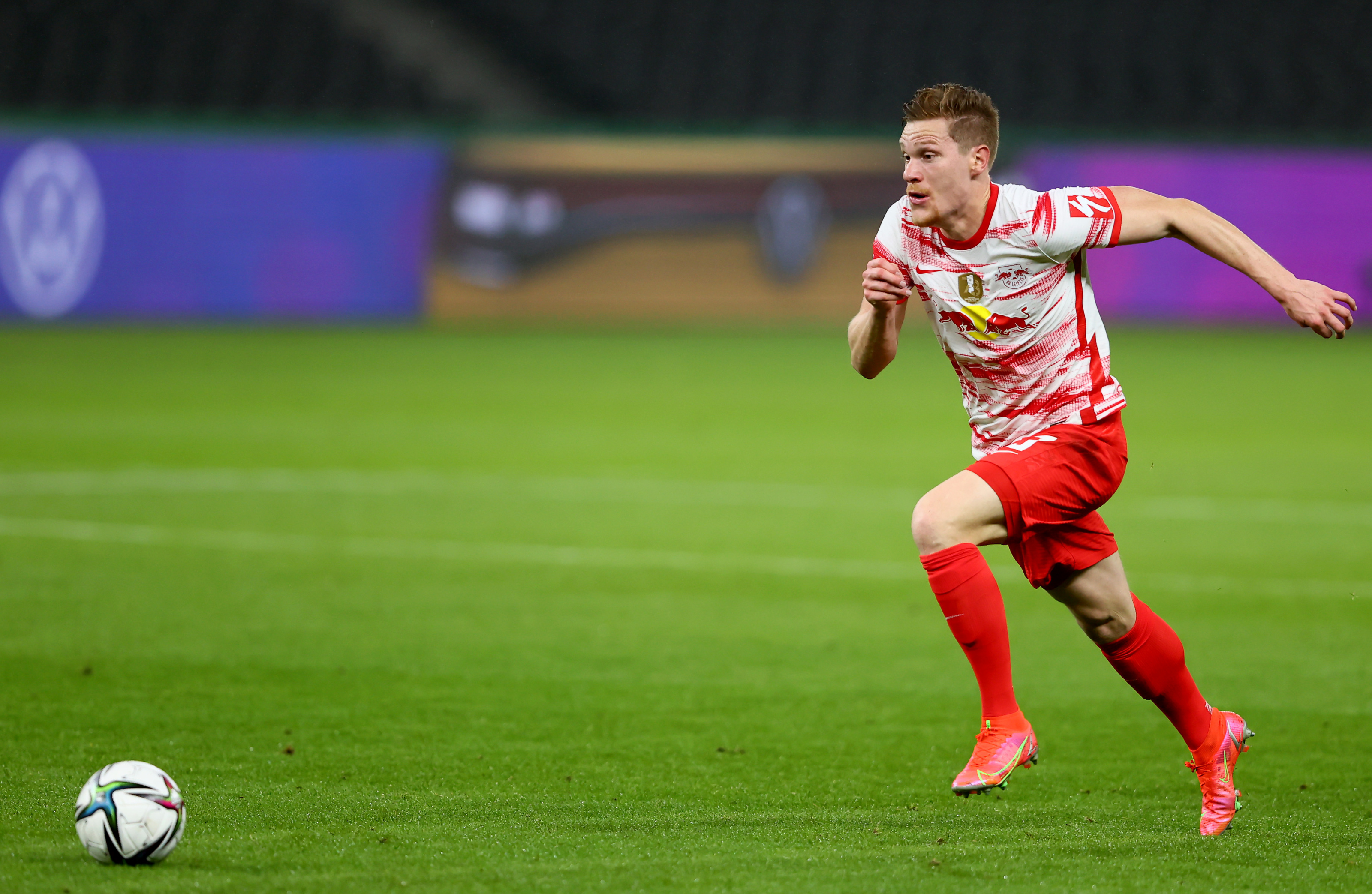 BERLIN, GERMANY - MAY 13: Marcel Halstenberg of RB Leipzig runs with the ball during the DFB Cup final match between RB Leipzig and Borussia Dortmund at Olympic Stadium on May 13, 2021 in Berlin, Germany. Sporting stadiums around Germany remain under strict restrictions due to the Coronavirus Pandemic as Government social distancing laws prohibit fans inside venues resulting in games being played behind closed doors. (Photo by Martin Rose/Getty Images)